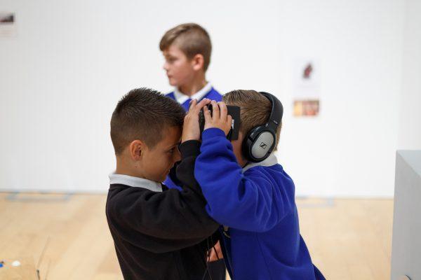 Boys exploring VR
